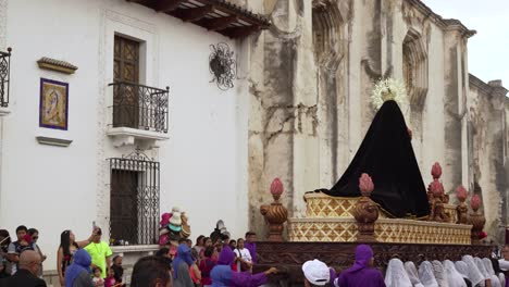 Women-carry-giant-statues-of-the-Virgin-mary-in-a-colorful-Christian-Pascua-celebration-in-Antigua-Guatemala