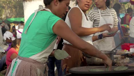 Women-prepare-food-at-a-Guatemala-street-market-stall