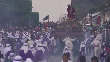 Robed-priests-carry-giant-coffins-in-a-colorful-Christian-Easter-celebration-in-Antigua-Guatemala-1