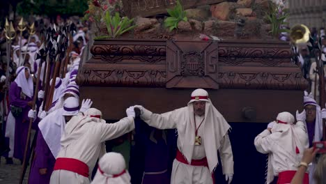 Robed-priests-carry-giant-coffins-in-a-colorful-Christian-Easter-celebration-in-Antigua-Guatemala-2