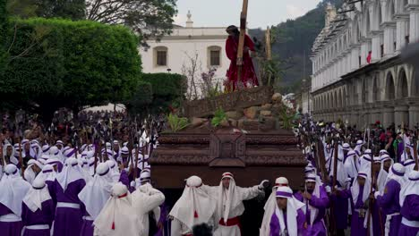 Robed-priests-carry-giant-coffins-in-a-colorful-Christian-Easter-celebration-in-Antigua-Guatemala-3