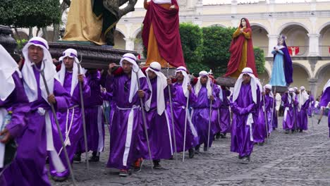 Robed-priests-carry-giant-statues-in-a-colorful-Christian-Pascua-celebration-in-Antigua-Guatemala