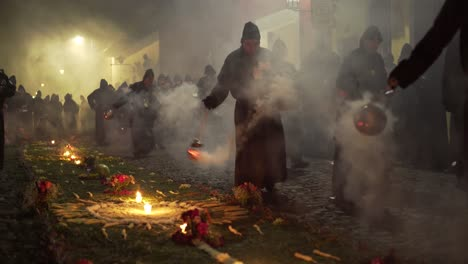 Purple-robed-priests-carry-incense-burners-at-night-in-a-colorful-Christian-Easter-celebration-in-Antigua-Guatemala