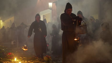 Purple-robed-priests-carry-incense-burners-at-night-in-a-colorful-Christian-Easter-celebration-in-Antigua-Guatemala-1