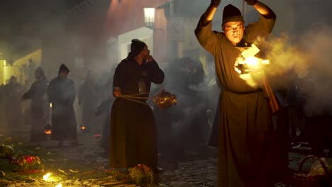 Purple-robed-priests-carry-incense-burners-at-night-in-a-colorful-Christian-Easter-celebration-in-Antigua-Guatemala-2