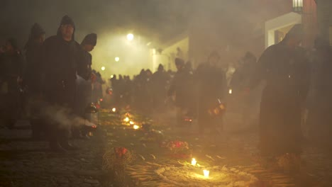 Purple-robed-priests-carry-incense-burners-at-night-in-a-colorful-Christian-Easter-celebration-in-Antigua-Guatemala-3