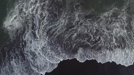 Beautiful-straight-down-aerial-over-ocean-waves-1