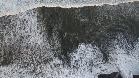 Beautiful-aerial-over-a-black-sand-beach-4