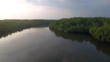 Aerial-shots-along-a-river-estuary-in-El-Paradon-Guatemala-1
