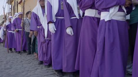 Purple-robed-Catholic-Christian-priests-march-in-the-Semana-Santa-Easter-week-holidays-in-Antigua-Guatemala-1