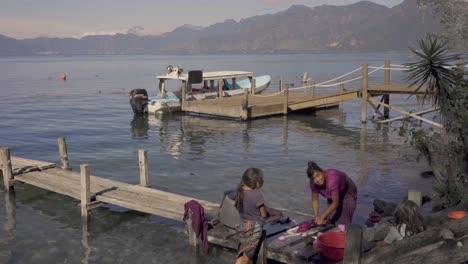 Maya-women-wash-clothes-beside-Lake-Atitlan-in-Guatemala