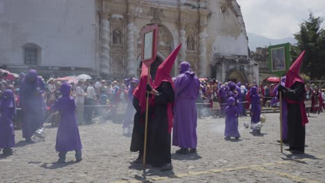 Purple-robed-Catholic-Christian-priests-cucaruchos-perform-in-the-Semana-Santa-Easter-week-holidays-in-Antigua-Guatemala