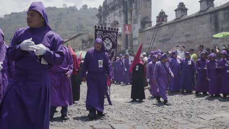 Purple-robed-Catholic-Christian-priests-march-in-the-Semana-Santa-Easter-week-holidays-in-Antigua-Guatemala-2
