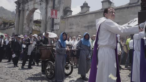 Purple-robed-Catholic-Christian-priests-march-in-the-Semana-Santa-Easter-week-holidays-in-Antigua-Guatemala-3