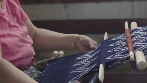 A-Maya-woman-weaves-using-a-traditional-loom-in-Guatemala-2