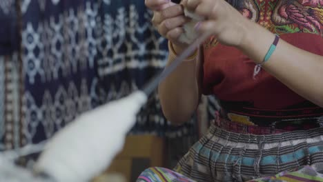 A-Maya-woman-demonstrates-textile-manufacture-with-some-raw-cotton-in-Guatemala