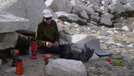 A-backpacker-cooking-dinner-in-the-wilderness