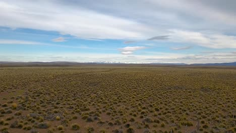 Beautiful-aerial-of-vast-patagonia-landscape-and-Andes-mountains-near-Bolson-Argentina