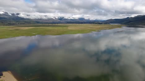 Beautiful-aerial-of-Andes-mountains-a-lake-and-pasture-land-near-Los-Alerces-National-Park-1