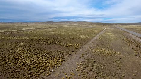 Aerial-drone-shot-of-desolate-Route-40-and-the-vast-Patagonia-landscape-in-Argentina