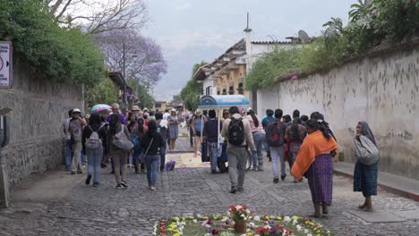 Pedestrians-walk-past-an-alfombra-during-Holy-Week-in-Antigua-Guatemala
