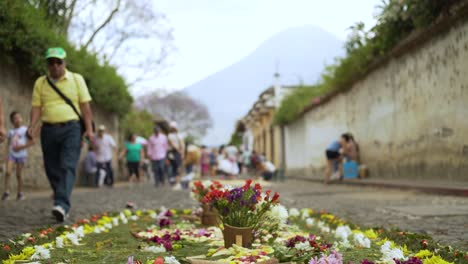 Pedestrians-walk-past-an-alfombra-during-Holy-Week-in-Antigua-Guatemala-1