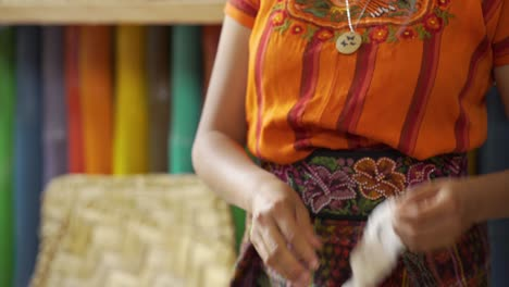 Beautiful-close-up-of-a-Maya-woman-weaver-separates-the-seeds-from-cotton-fibers-by-hand