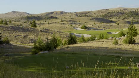 A-golf-tee-and-green-on-the-Rock-Creek-Cattle-Company-golf-course-in-Montana