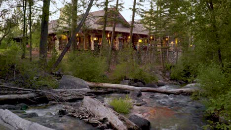 A-rushing-stream-and-the-club-house-at-the-Rock-Creek-Cattle-Company-in-Montana