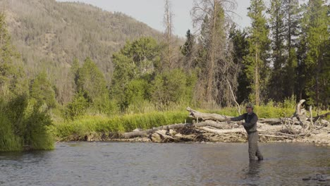 A-fly-fisherman-casting-on-a-quiet-trout-stream-in-Central-Montana