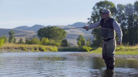 A-fly-fisherman-on-a-beautiful-summer-morning-casts-for-trout-in-a-Montana-river-3