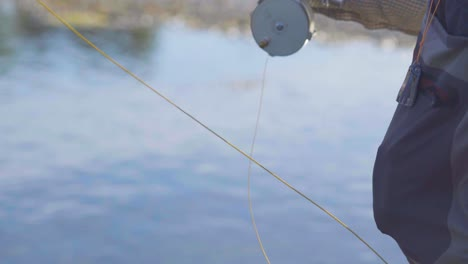 A-fly-fisherman-on-a-beautiful-summer-morning-casts-for-trout-in-a-Montana-river-4