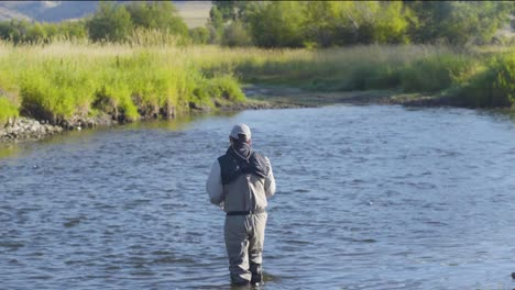 A-fly-fisherman-on-a-beautiful-summer-morning-casts-for-trout-in-a-Montana-river-5