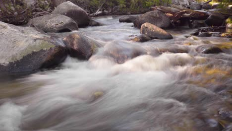 Slow-motion-slow-shutter-speed-clip-of-a-rushing-stream-in-early-morning-light