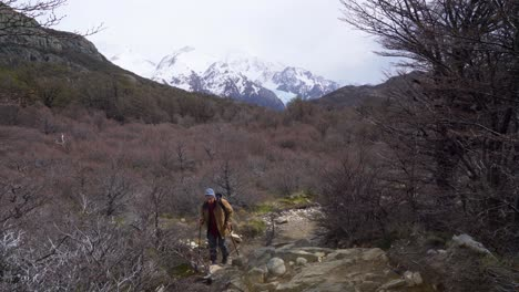 A-hiker-treks-thru-the-wilderness-on-an-adventure-in-cloudy-windswept-Fitz-Roy-National-Park-Argentina-5