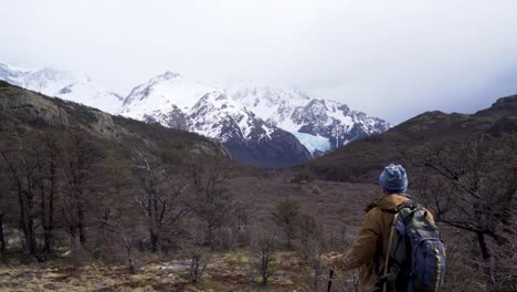 A-hiker-treks-thru-the-wilderness-on-an-adventure-in-cloudy-windswept-Fitz-Roy-National-Park-Argentina-6