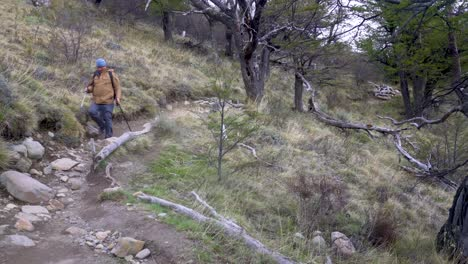 A-hiker-treks-thru-the-wilderness-on-an-adventure-in-cloudy-windswept-Fitz-Roy-National-Park-Argentina-8