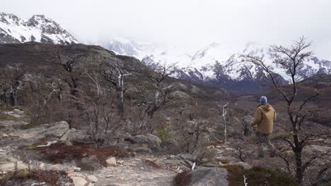 A-hiker-treks-thru-the-wilderness-on-an-adventure-in-cloudy-windswept-Fitz-Roy-National-Park-Argentina-9