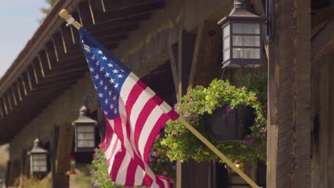 An-American-flag-flying-outside-of-a-rustic-storefront-in-Montana