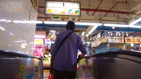 Following-shot-through-indoor-food-stalls-and-vendors-in-a-market-in-Hong-Kong-China