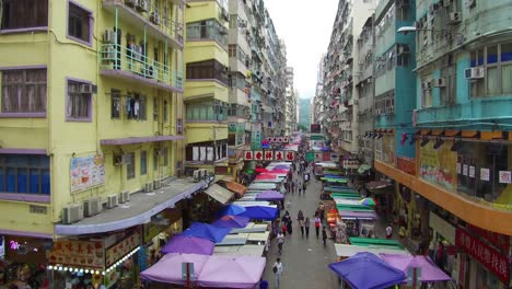 Tilt-up-to-reveal-busy-streets-and-apartment-complex-of-Hong-Kong-China
