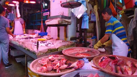 A-meat-seller-in-Hong-Kong-cuts-meat-with-a-knife-for-a-customer-1
