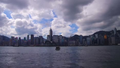 Panning-shot-across-Hong-Kong-harbor-and-skyline-with-clouds