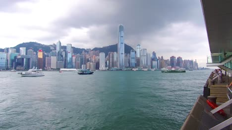 Panning-shot-across-Hong-Kong-harbor-and-skyline-with-clouds-1