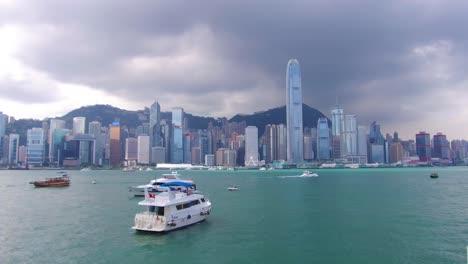 Establishing-shot-across-Hong-Kong-harbor-and-skyline-with-clouds