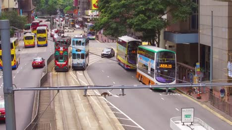 Establishing-shot-of-a-Hong-Kong-street-with-busses-and-trolley