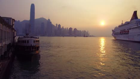 Panning-shot-across-Hong-Kong-harbor-and-skyline-with-clouds-4