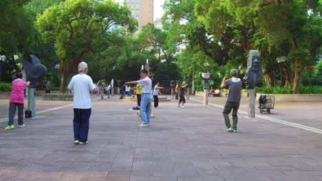 Chinese-seniors-practice-tai-chi-in-a-park-in-the-early-morning-in-Hong-Kong-China-2