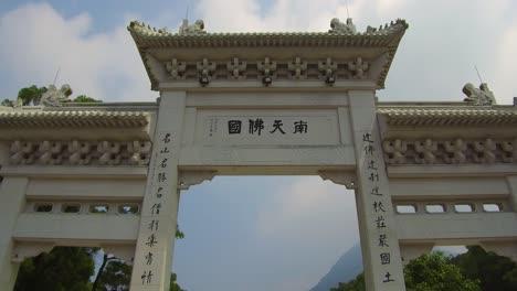 Establishing-shot-of-a-giant-gate-at-Tian-Tan-Buddha-on-Lantau-Island-Hong-Kong-China