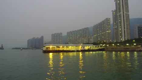 Massive-apartments-line-a-shoreline-in-China-at-dusk